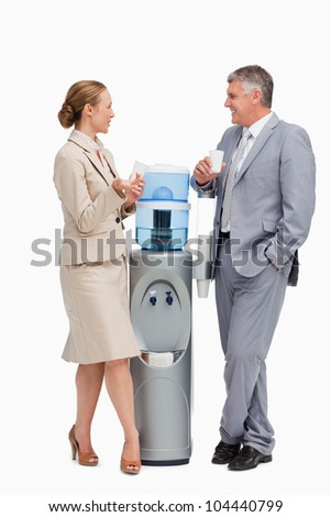 Business people talking next to the water dispenser  against white background - stock photo