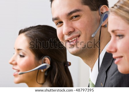 Business people talking on headsets - stock photo