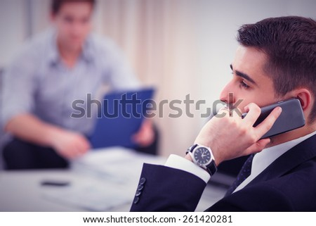 Business people talking on phone at office - stock photo