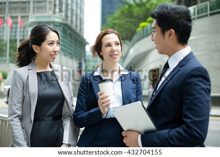 Business people talking to each other at outdoor