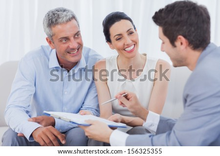 Business people talking together on sofa at office - stock photo
