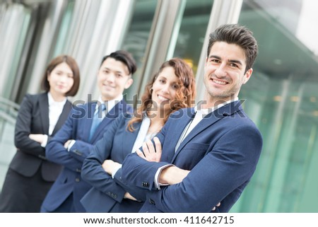 business people team crossed arm with office window - stock photo