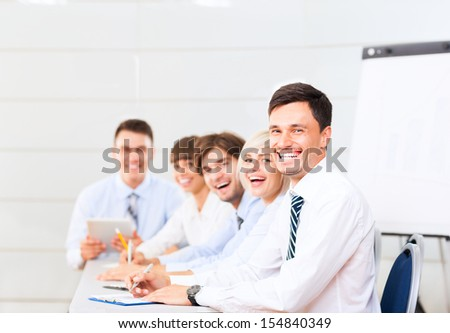 business people team smile sitting at desk in office meeting conference room, businesspeople group working board room with colleague in row line  - stock photo