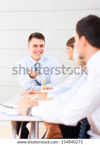business people team working smile discussing sitting at desk in office meeting conference room, businesspeople group in board room with colleague in row line