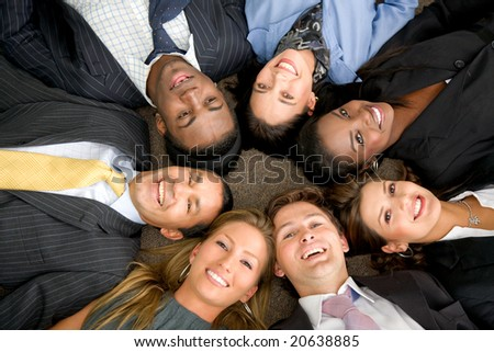 business people teamwork in an office with heads together - stock photo