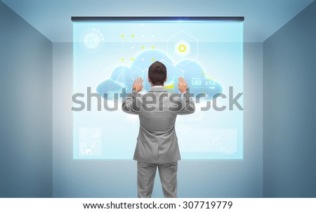 business, people, technology and cloud computing concept - businessman working with virtual screen over gray room background from back - stock photo