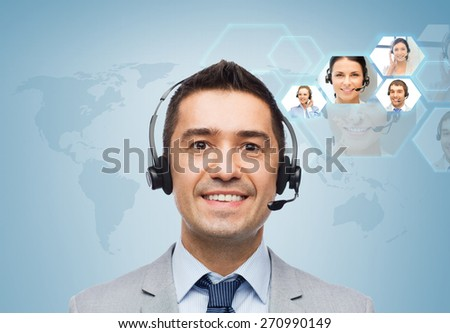 business, people, technology and communication concept - smiling businessman in headset over virtual contacts icons projection and blue background - stock photo