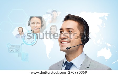 business, people, technology and communication concept - smiling businessman in headset over virtual contacts icons projection and blue background