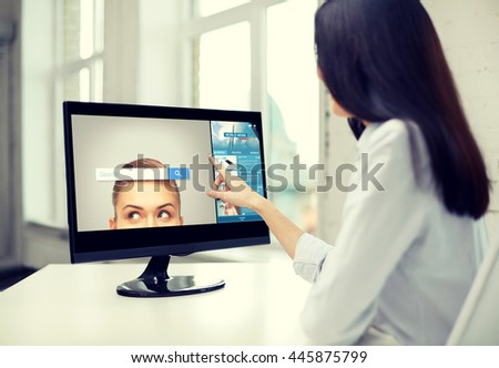 business, people, technology and internet concept - close up of woman pointing finger to web browser search bar on computer monitor in office - stock photo