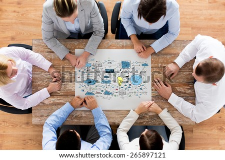 business, people, technology and planning concept - close up of creative team with scheme sitting at table in office - stock photo