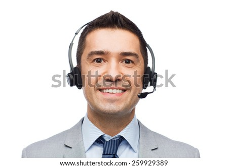 business, people, technology and service concept - smiling businessman in headset - stock photo