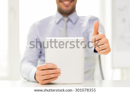 business, people, technology, gesture and teamwork concept - close up of businessman hands with tablet pc computer showing thumbs up at office - stock photo