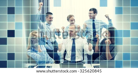 business, people, technology, gesture and teamwork concept - smiling business team raising hands and celebrating victory in office over blue squared grid background - stock photo