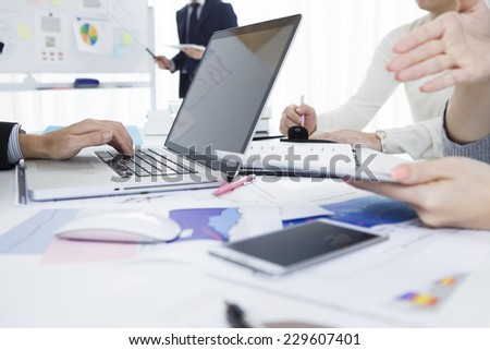 Business people to conversation in the office - stock photo
