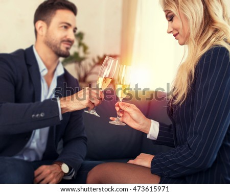 Business people toast in office, young businessman and businesswoman, business meeting