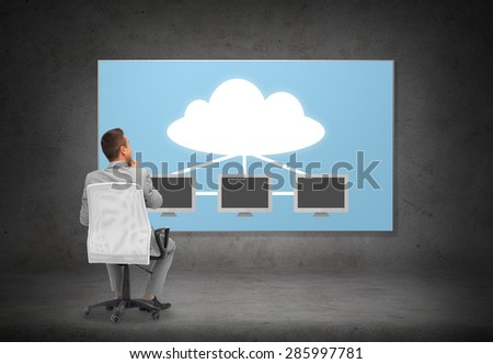 business, people, transferring data and technology concept - businessman in suit sitting in office chair over screen with cloud and server computers on gray wall background from back - stock photo