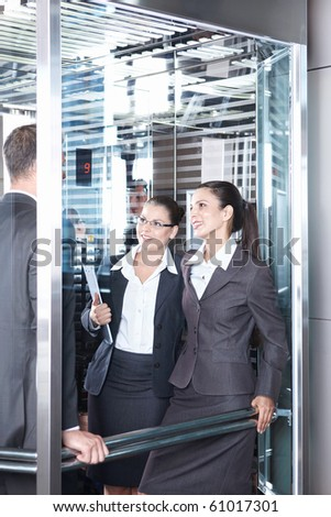 Business people traveling in an elevator - stock photo