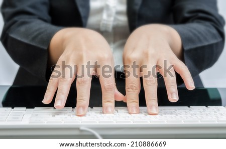 Business people typing on computer keyboard - stock photo