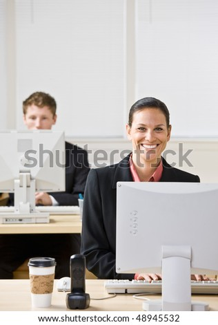 Business people typing on computers - stock photo