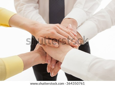 Business people uniting their hands - gesture of a uniion, white background