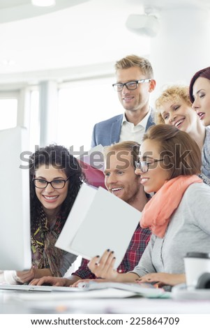 Business people using computer in creative office - stock photo