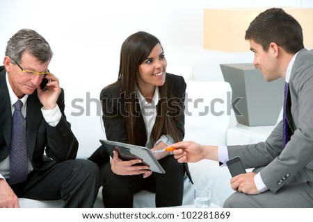 Business people using digital tablet at meeting. - stock photo