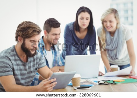 Business people using technology at office - stock photo