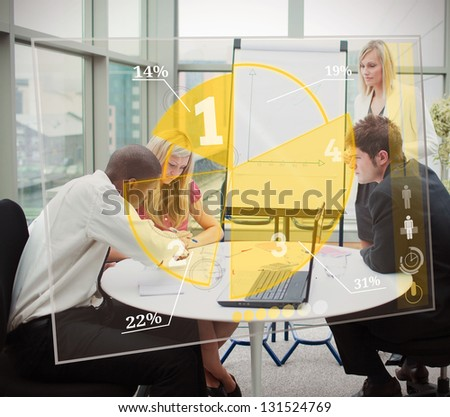 Business people using yellow pie chart interface during presentation - stock photo