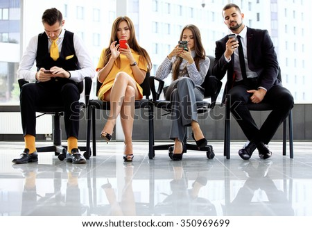 Business people waiting for job interview in office - stock photo