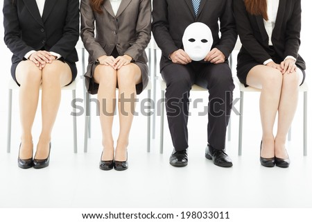 business people waiting for job interview with a strange mask  - stock photo
