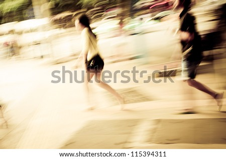 business people walk on street, abstract blur - stock photo
