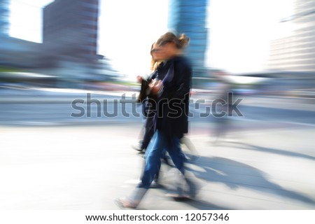 Business people walking along office building - stock photo