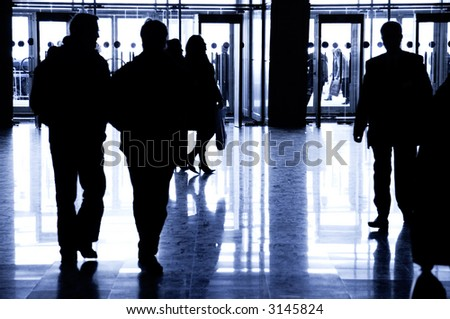 Business people walking. Big hall at Moscow exhibition. Specially with high contrast. - stock photo