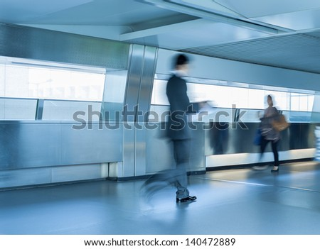 Business people walking  (blurred motion)