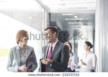 Business people walking in corridor - stock photo