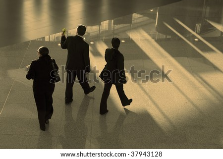 business people walking in the airport - stock photo