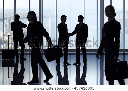 Business people walking in the office center - stock photo
