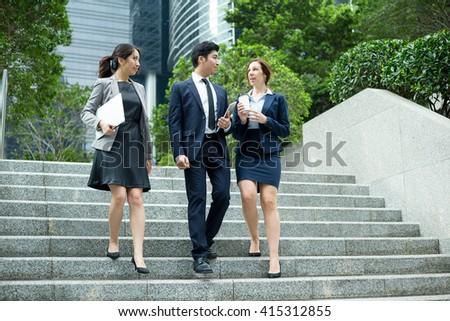 Business people walking outside office - stock photo