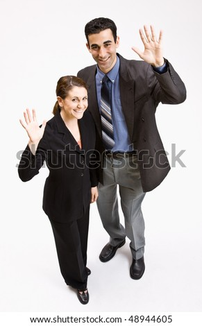 Business people waving - stock photo
