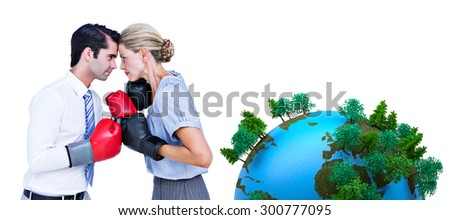 Business people wearing and boxing red gloves against earth with forest - stock photo