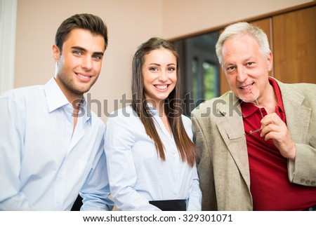 Business people wearing informal dresses at work in their office - stock photo