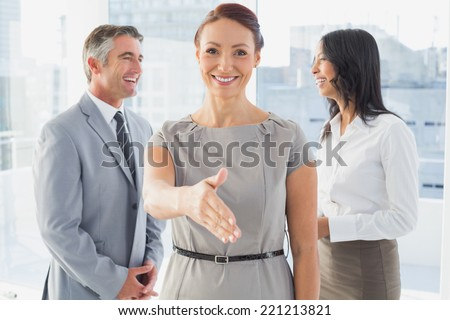 Business people welcoming new staff to work - stock photo