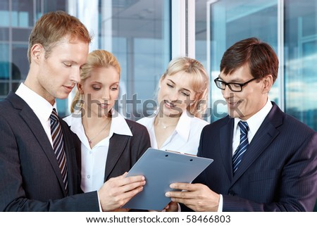 Business people who read the contract - stock photo