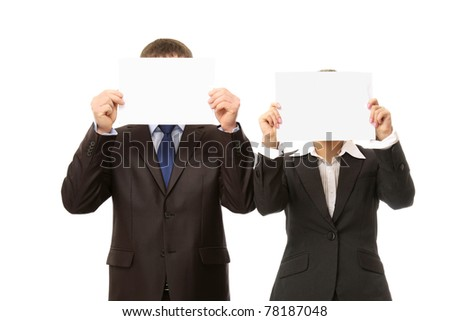 Business people with empty blanks hiding their faces