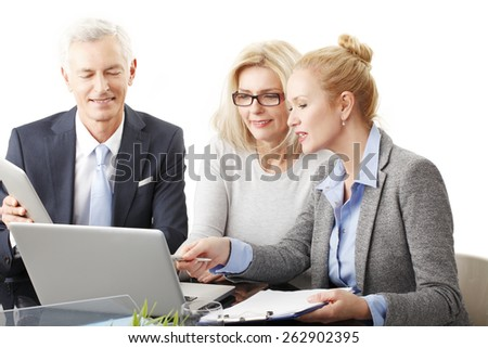 Business people with laptop and digital tablet sitting at desk and working on presentation. Isolated on white background.  - stock photo