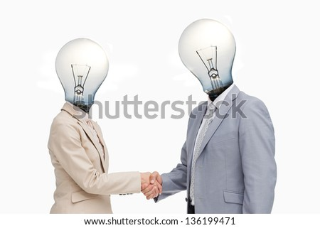 Business people with lightbulb heads greeting with a handshake against white background - stock photo