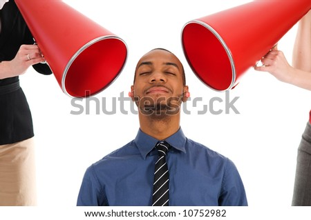 business people with megaphone harassing colleague - stock photo