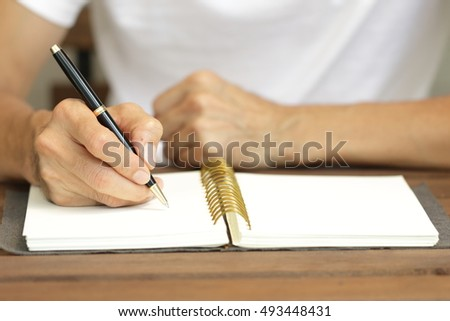 business people  with pen and organization diary,selective focus on hand  and pen