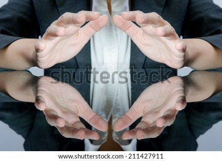 Business people with protect the light under hand - stock photo
