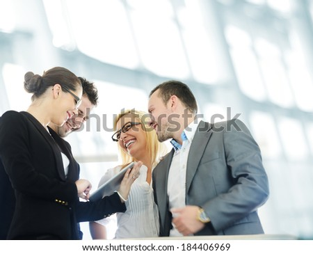 Business people with tablet in modern building - stock photo